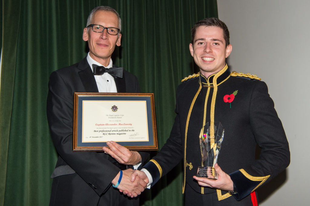 Captain Alexander MacLaverty (right) winner of The Best Professional Article Published in the RLC Review Magazine.